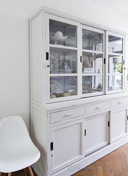 milk paint hutch makeove in white via Songbirdblog