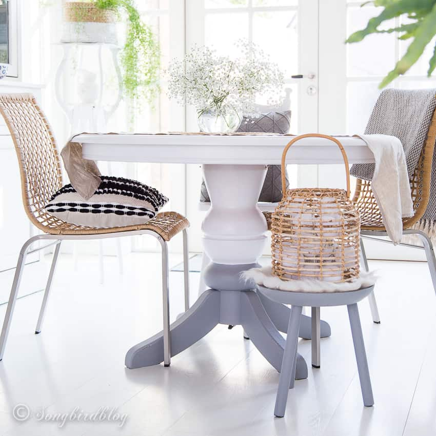 white and grey painted round dining table