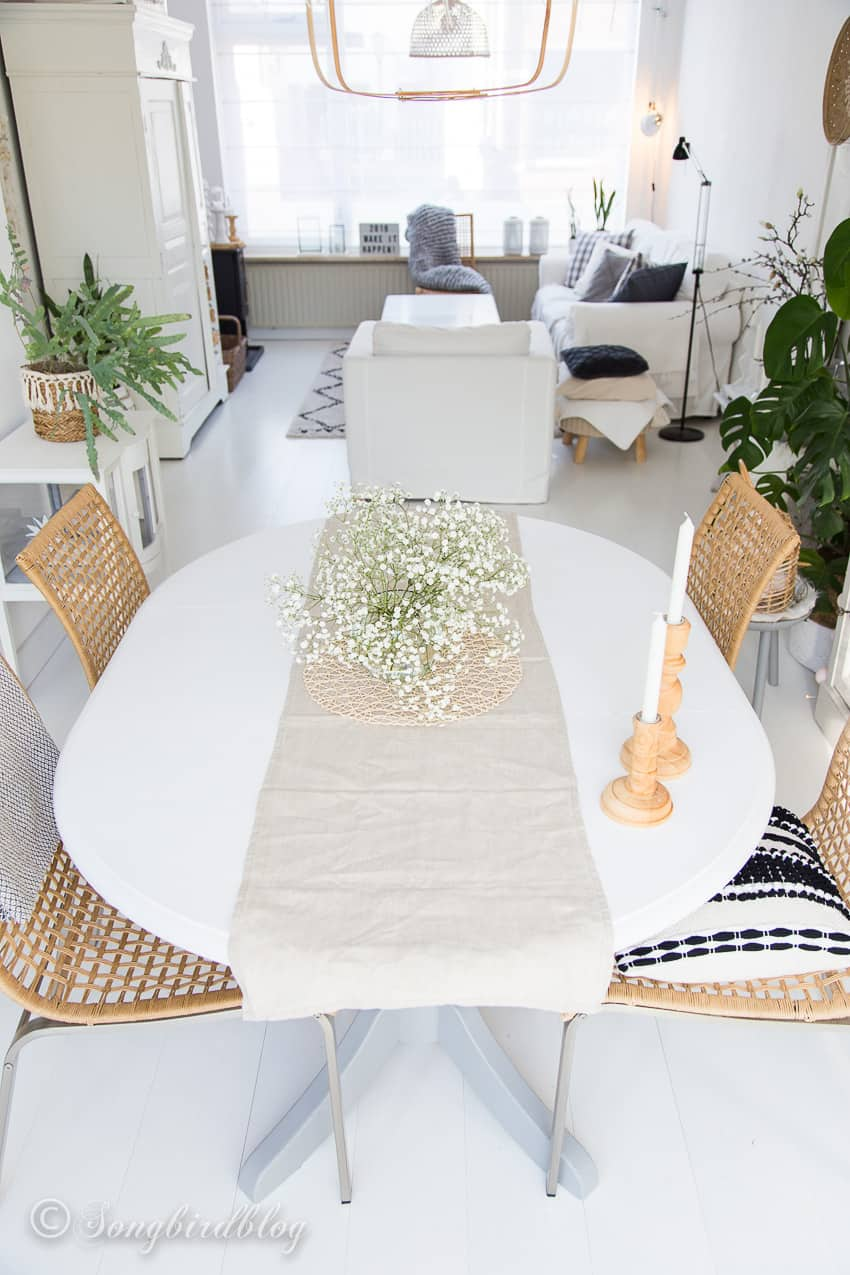 Overview of white interior living room with painted pine dining table