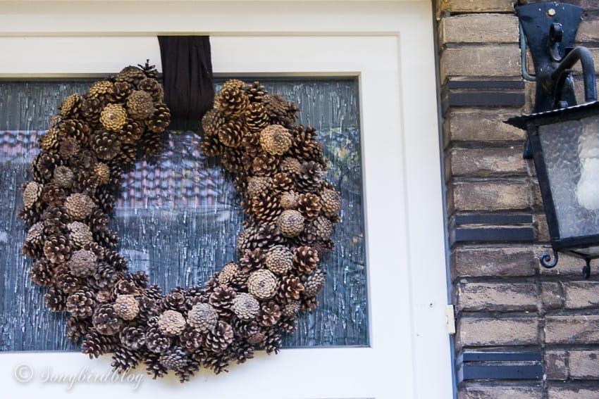 pinecone wreath on door