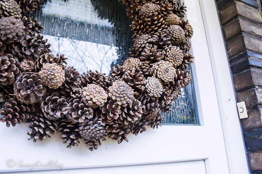 pinecone wreath on door close up