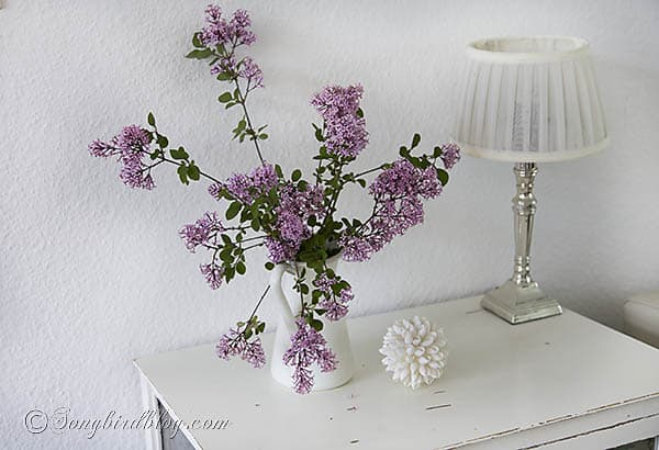 bouquet of pink lilac flowers in white vase. www.songbirdblog.com