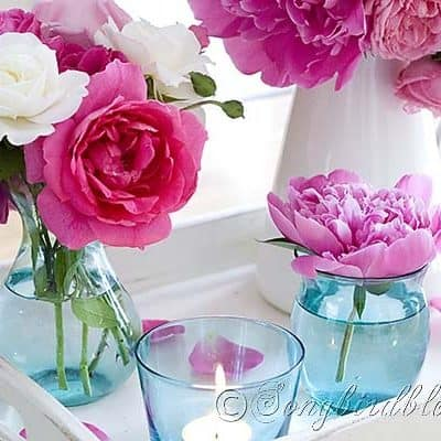 table decoration with pink roses and peonies in aqua vases