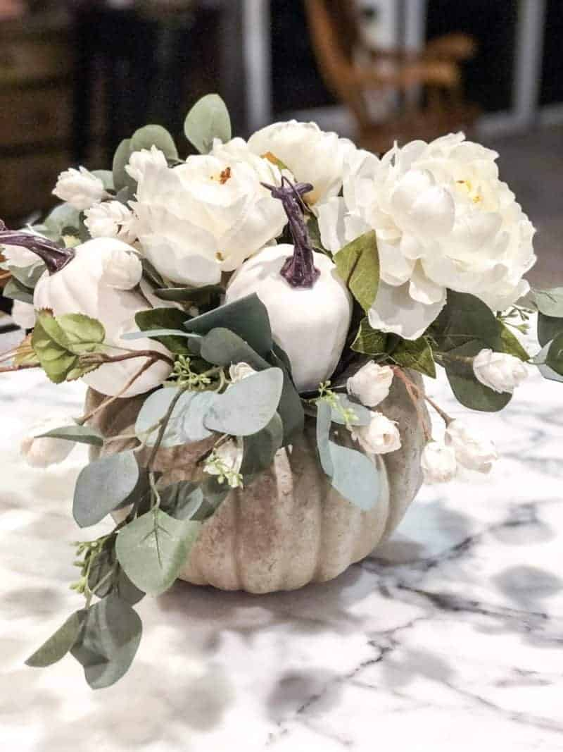Create a Fall centerpiece with fresh flowers and a pumpkin
