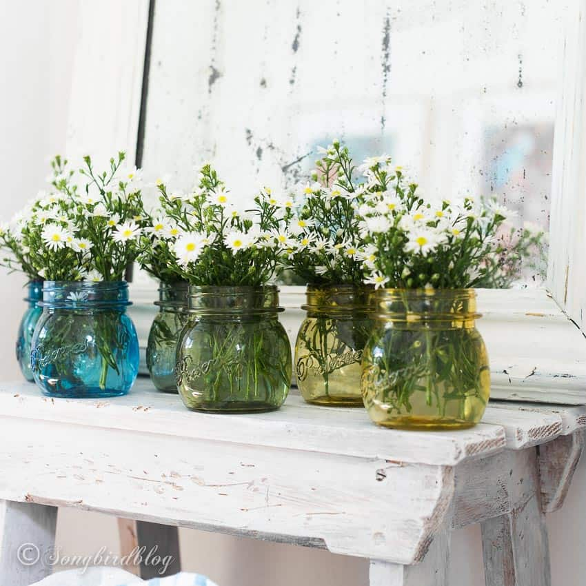 Ombre colored glass jars on a bench