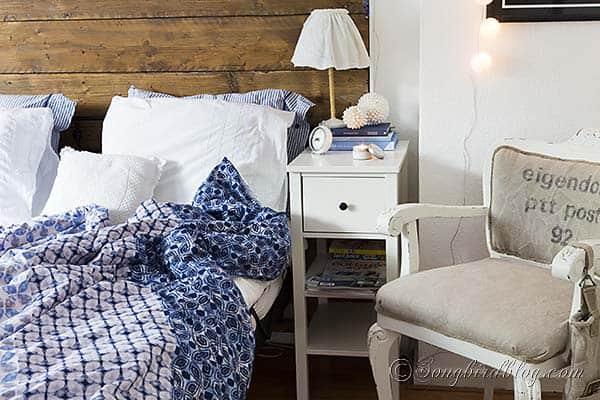 reclaimed wood headboard bed linen blue blanket