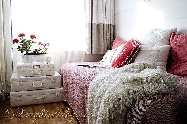 red and white bed room pillows