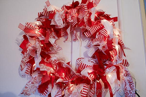 Christmas wreath made from red & white fabric scraps and lights