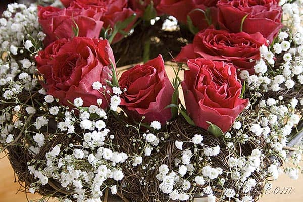 red roses in a wreath bouquet
