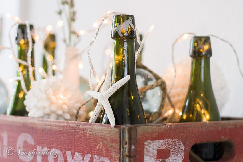 rustic nautical home decor with vintage crate and bottles