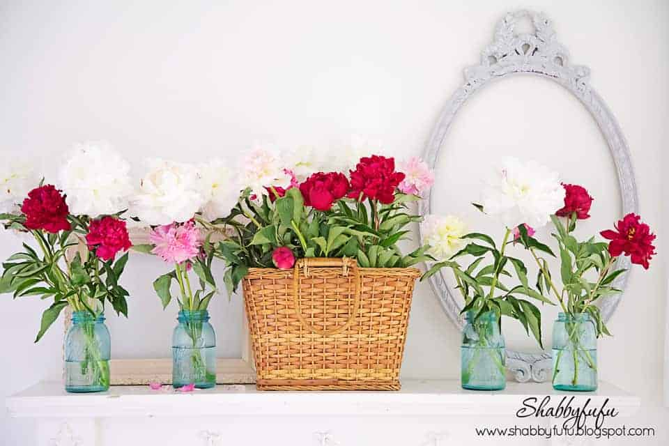 summer mantel idea with colorful flowers
