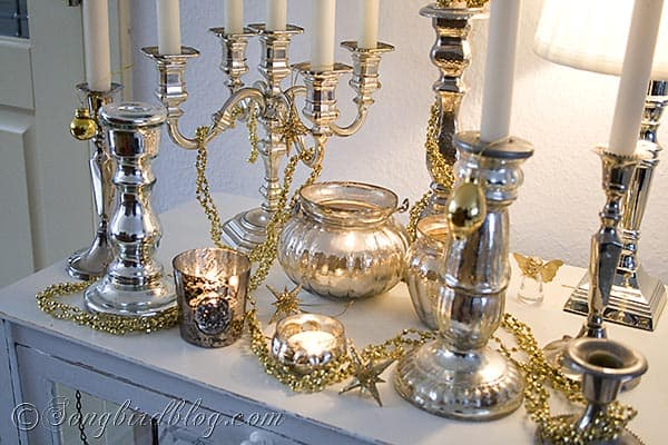 mercury silver candle sticks and gold decorations