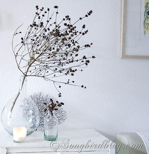 fall decoration with branch en glass vase
