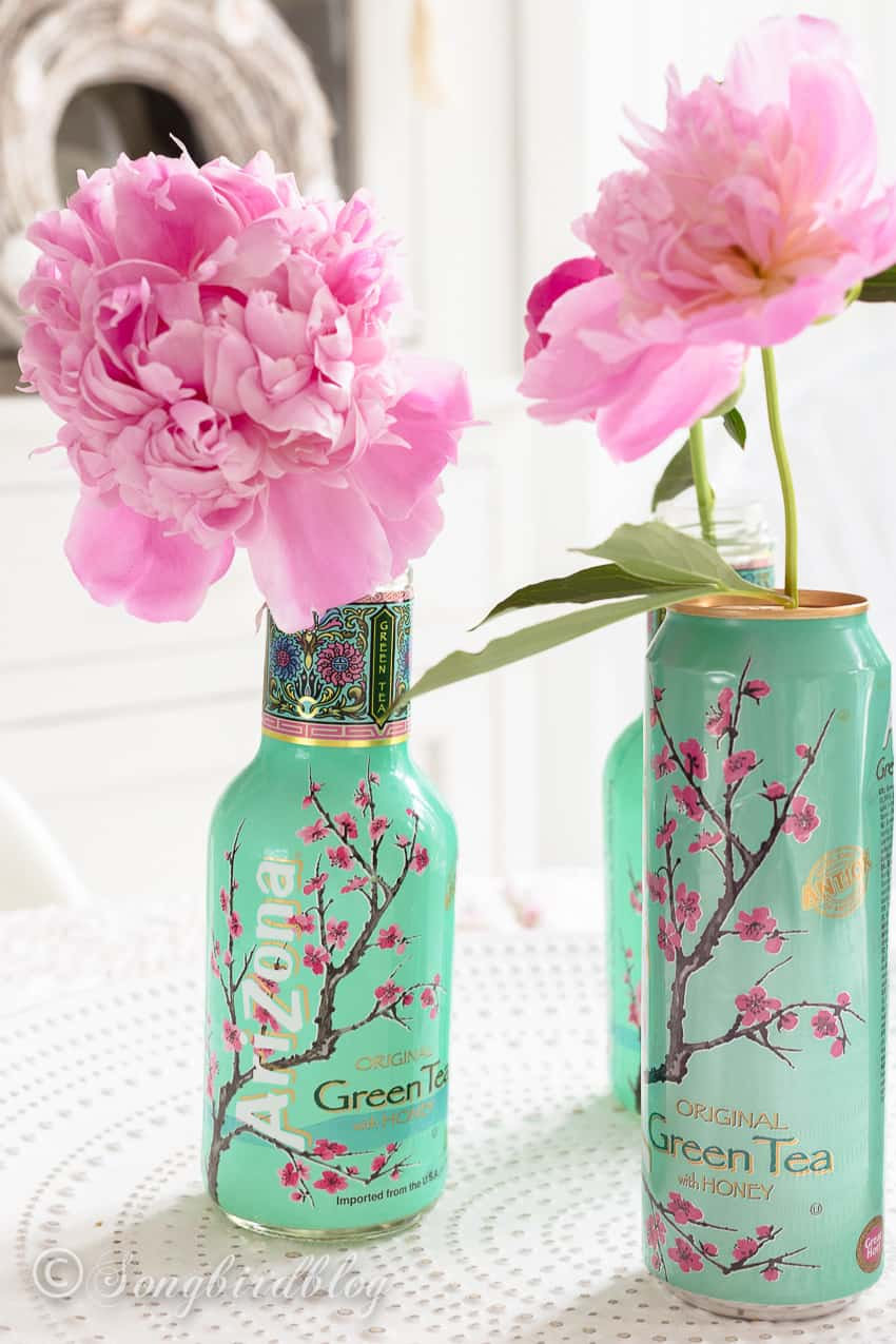 Arizona soda cans used a pretty vases for pink peonies