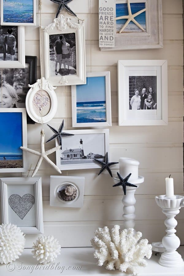 here is my summer beach mantel i added sea images to a layered photo frame