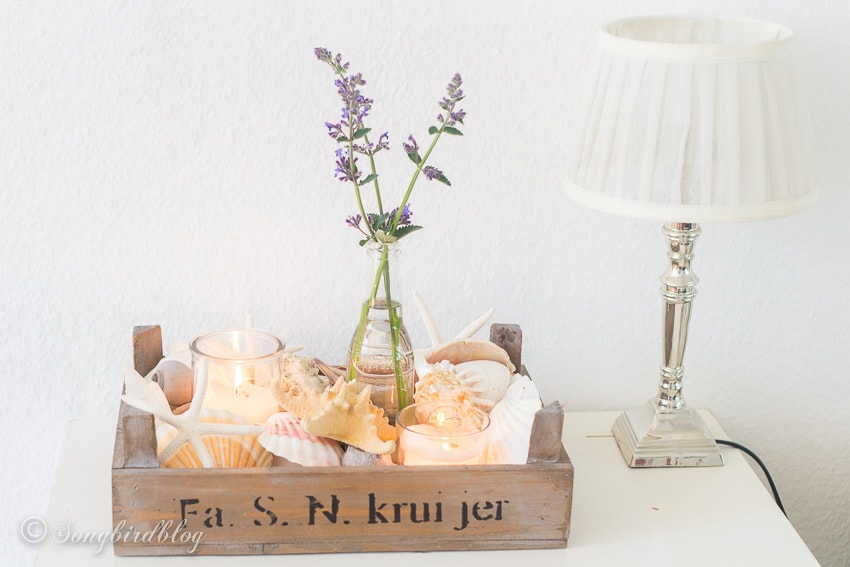 crate with coastal decorations for summer