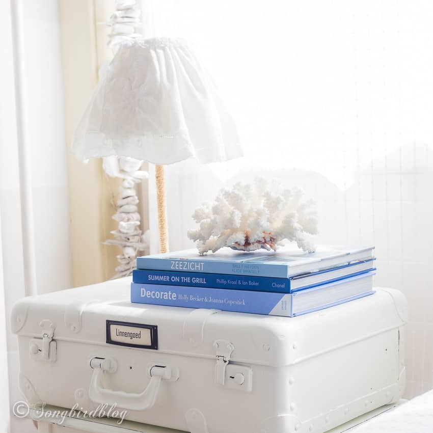 night stand made from white painted suitcase