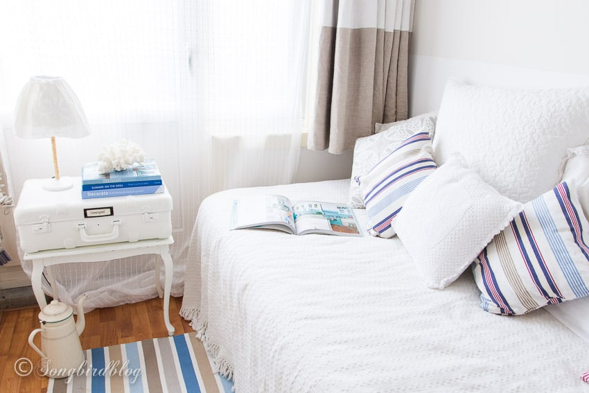 Summer bedroom with bed and side table