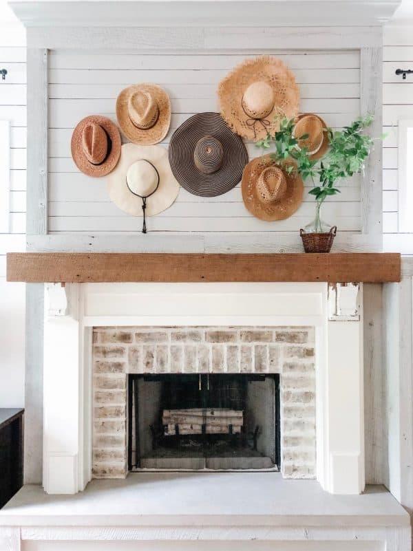 summer mantel idea with straw hats