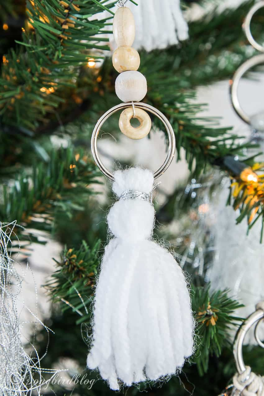 white tassel ornament with wooden beads