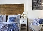 thumb Ikea Hemnes mirror in bedroom with repurposed wood headboard and blue bedding #
