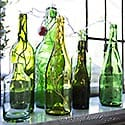 thumb green bottles with light string on window sill