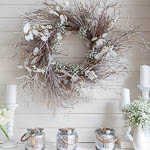 White winter mantel with a touch of Spring