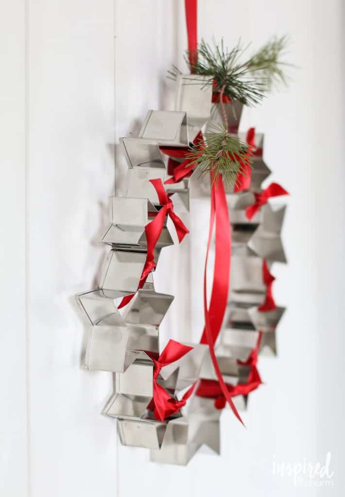A wreath made from star shaped cookie cutters.