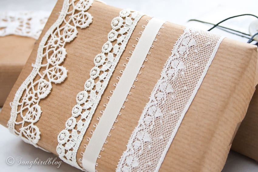 vintage christmas gift wrap with brown paper and a collection of lace ribbons