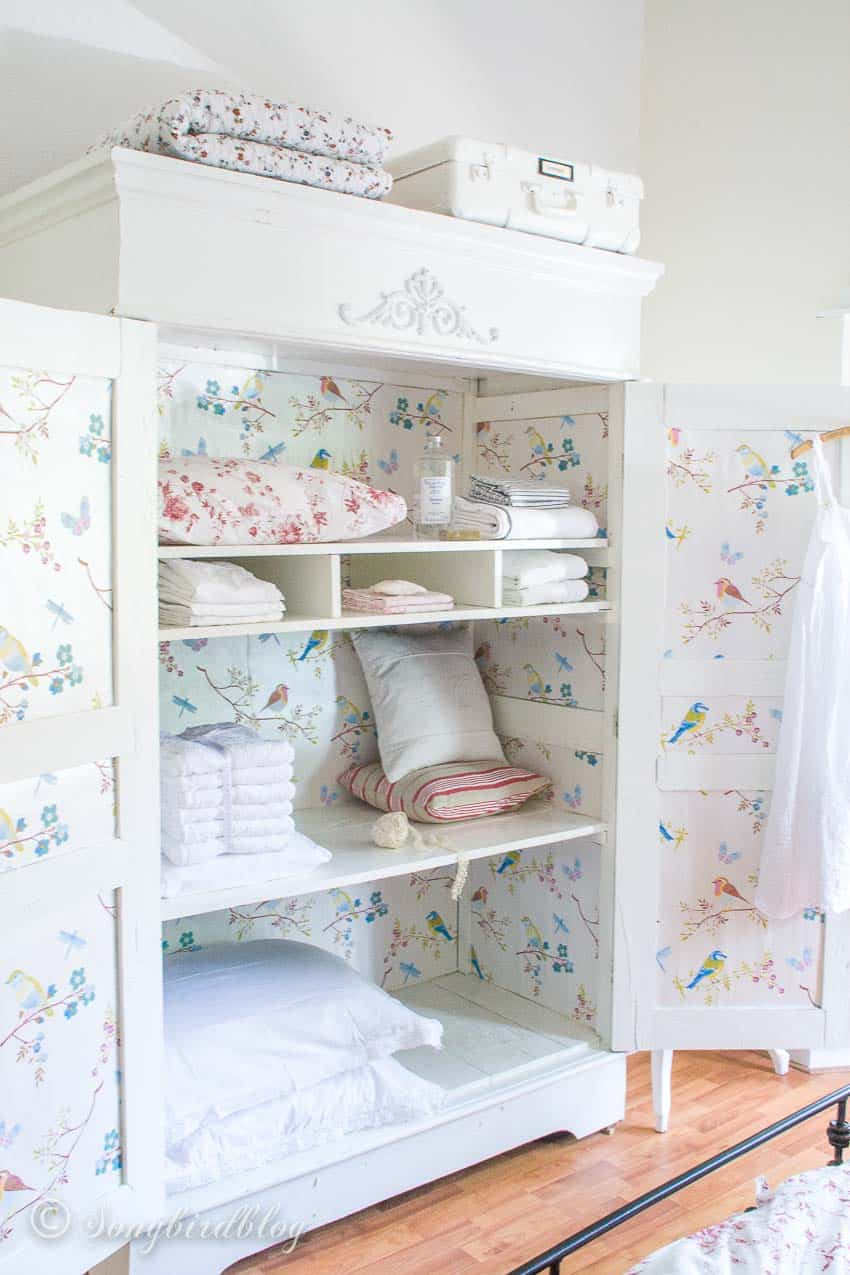 painted wardrobe with wallpaper inside