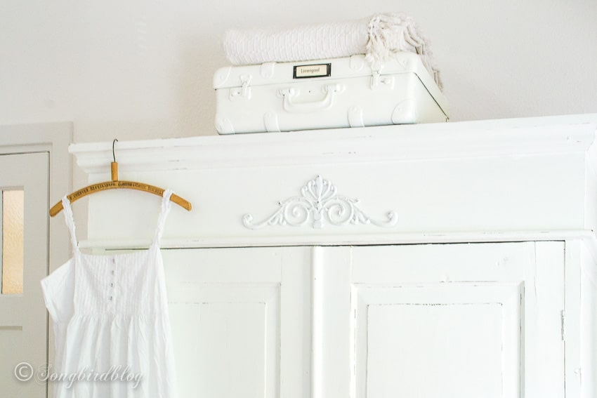 top detail white painted wardrobe