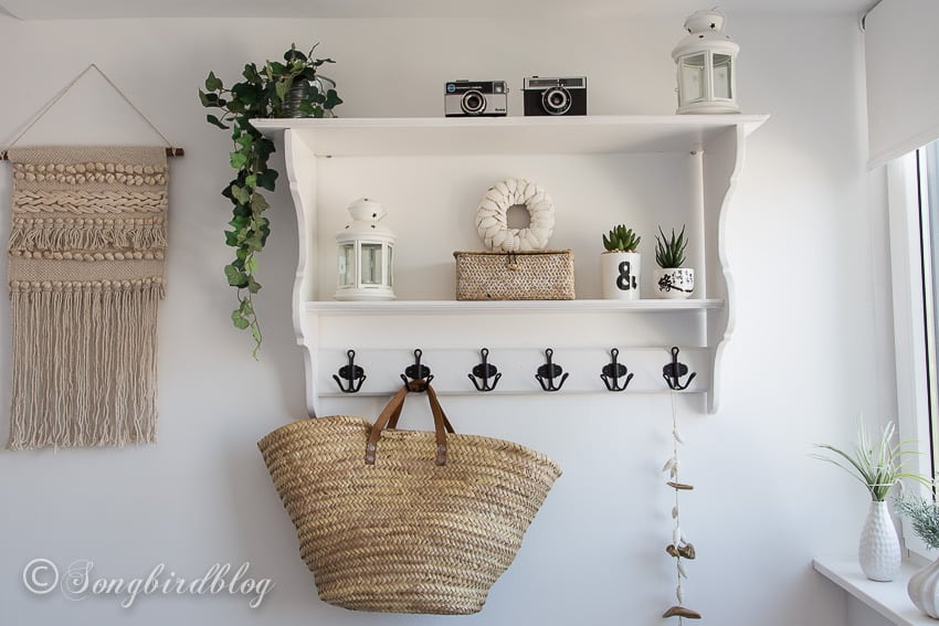 wall shelf with accessories in white boho bedroom