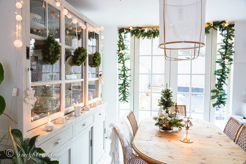 white dining room with farmhouse christmas decorations