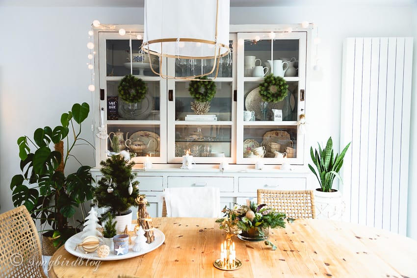 white dining room with christmas decorations