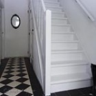 white painted hallway and staircase thumb