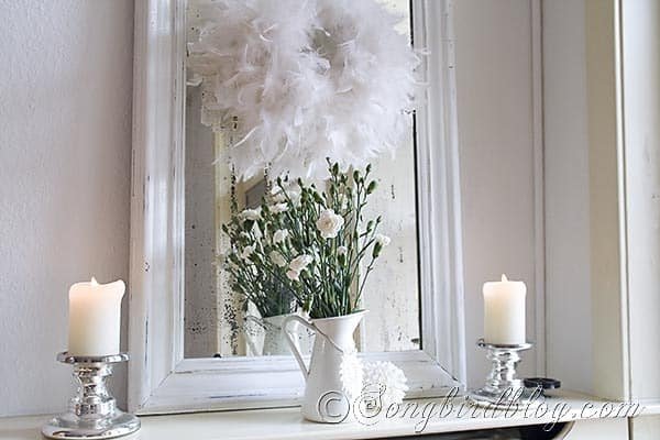Simple white mantel decoration ofr winter.  www.songbirdblog.com