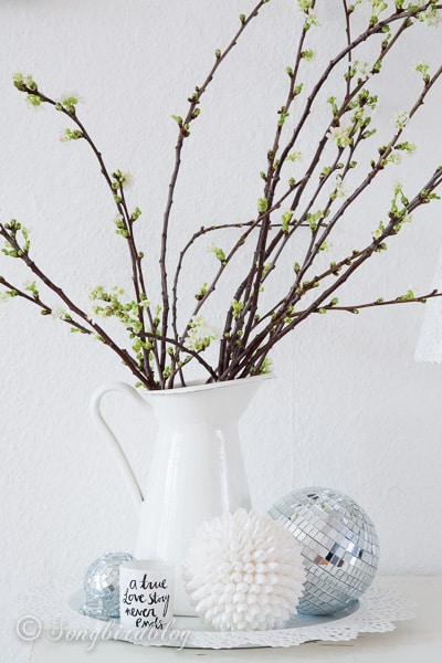 Apple Blossom Spring Decoration in white with some fun disco balls throw in for added interest.