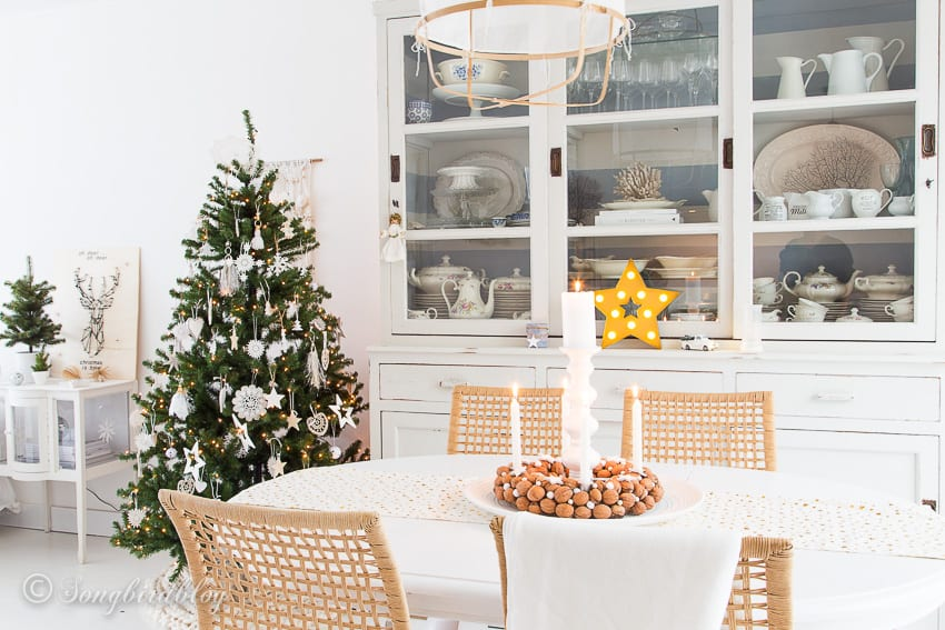 Dining room with winter white Christmas decorations