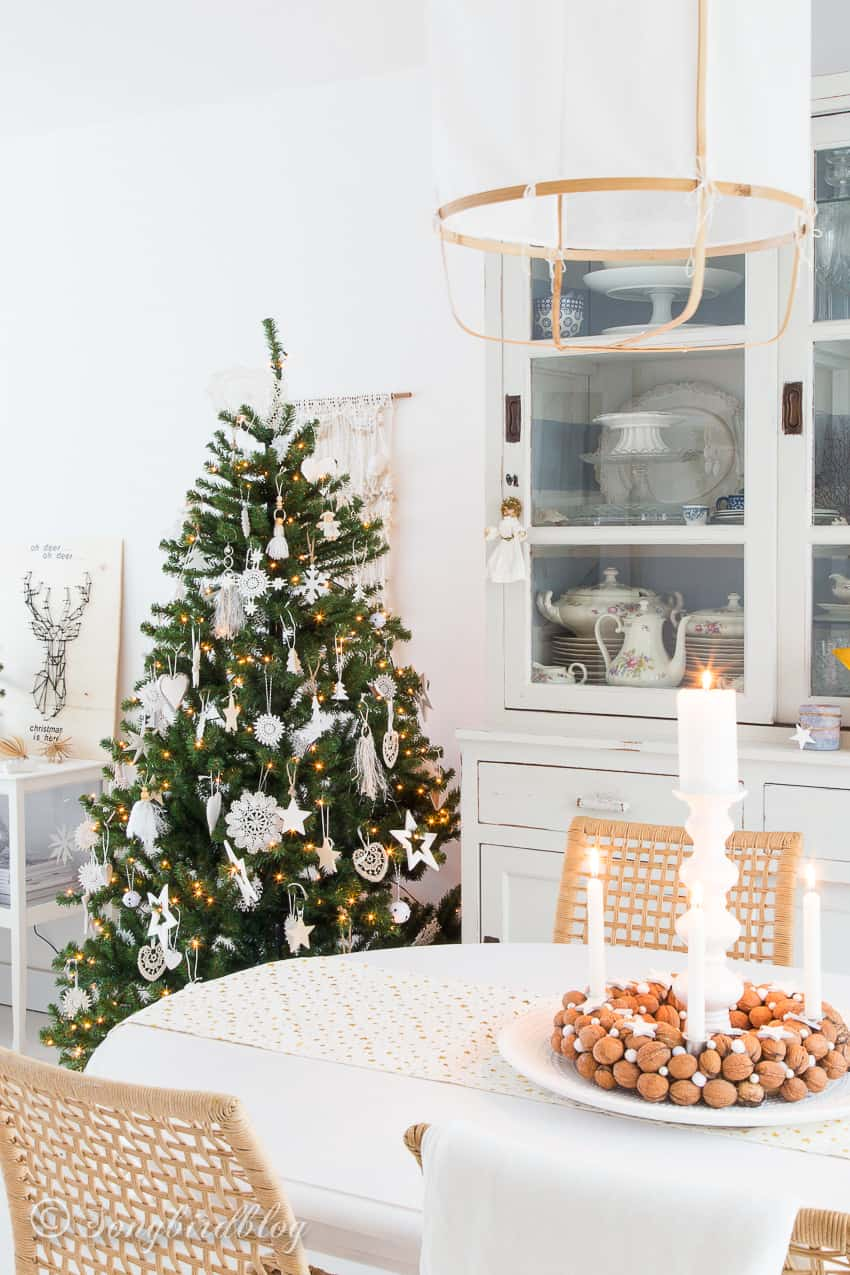 Dining room decorated in white for Christmas