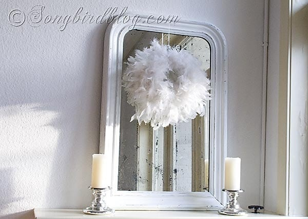 winter white feather wreath mantel