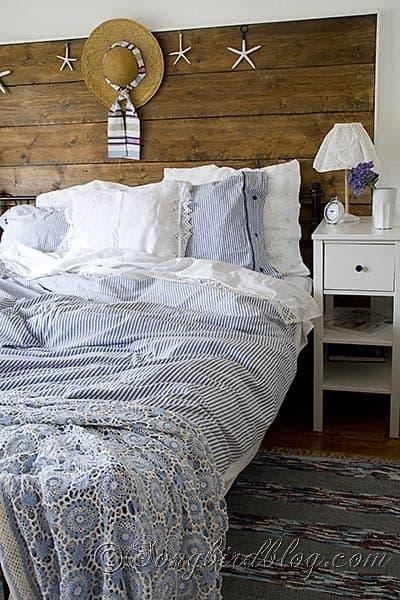 wood headboard blue linens bedroom