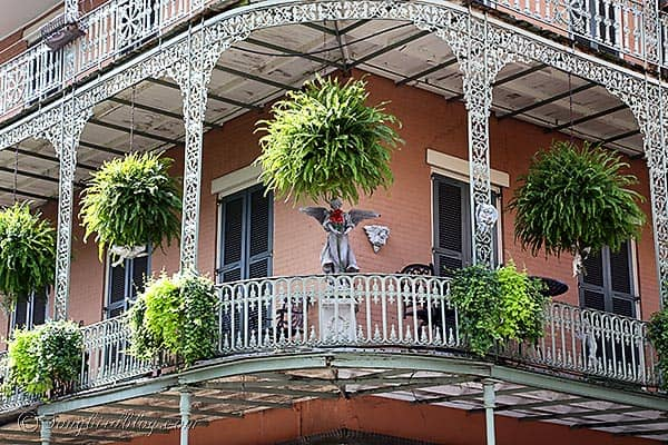 wrought iron balcony angel New Orleans